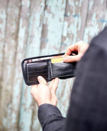 man holding wallet